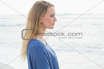 Side view of a serious casual woman at beach