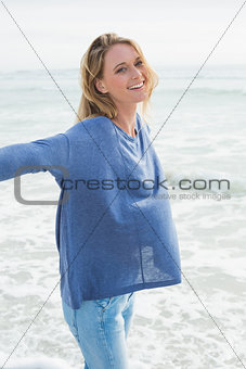 Smiling casual young woman at beach
