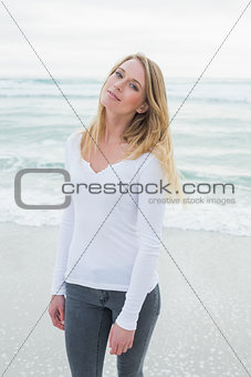 Portrait of a smiling casual woman at beach