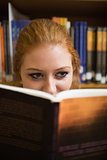Redhead student reading a book