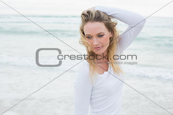 Casual woman looking away at beach