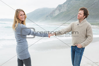 Casual couple holding hands at beach