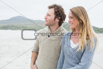 Happy casual couple at beach