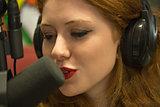 Pretty redhead student hosting a radio show