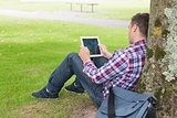 Student using his tablet pc outside