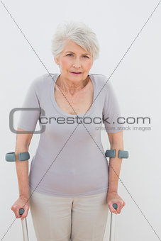 Portrait of a senior woman with crutches