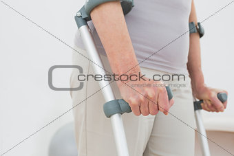 Close-up mid section of a woman with crutches