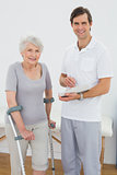 Therapist and disabled senior patient with reports