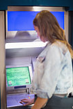 Student entering pin at the atm
