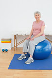 Portrait of a senior woman sitting on fitness ball