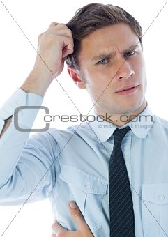 Thinking businessman scratching head