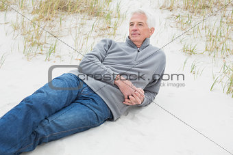 Casual senior man relaxing at beach