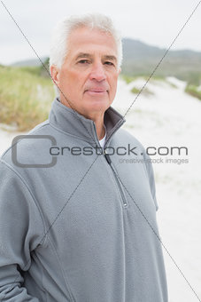 Portrait of a casual senior man at beach