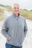 Portrait of smiling casual senior man at beach