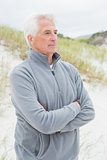 Contemplative senior man at beach