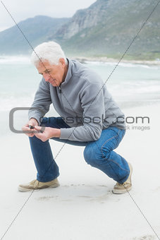 Side view of a senior man relaxing at beach