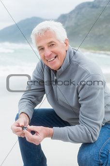 Portrait of a happy senior man relaxing at beach