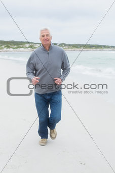 Full length of a senior man running at beach