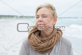 Close-up of a contemplative senior woman at beach
