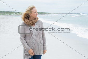 Casual senior woman looking away at beach