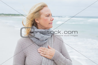 Contemplative casual senior woman at beach