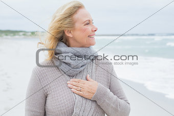 Happy senior woman looking away at beach
