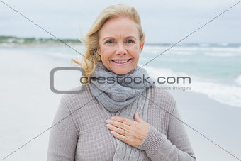 Smiling senior woman relaxing at beach
