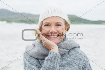 Smiling casual senior woman at beach