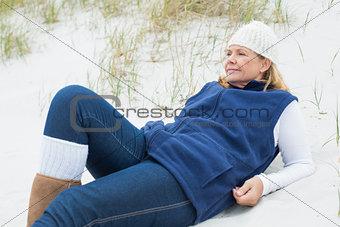 Relaxed contemplative senior woman at beach