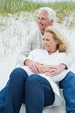 Romantic senior couple relaxing at beach