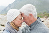 Close-up side view of a romantic senior couple together