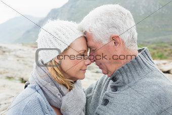 Close-up side view of a romantic senior couple