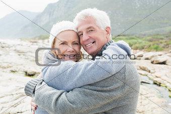 Portrait of a romantic senior couple hugging