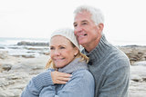 Romantic senior couple together on beach
