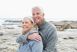 Romantic senior couple together on rocky beach