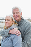 Romantic senior couple on rocky beach