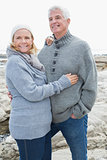 Romantic senior couple on a rocky beach