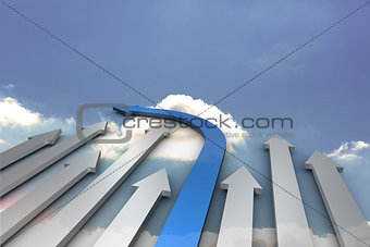 Blue and grey arrows pointing against sky