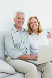 Portrait of a relaxed senior couple using laptop