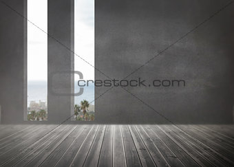 Grey room with windows showing the ocean