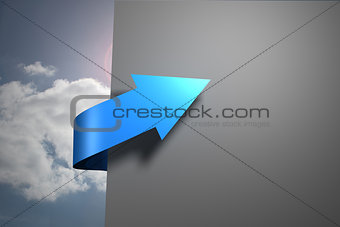 Blue arrow pointing against sky around grey wall