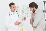 Male doctor explaining the spine to a patient