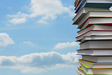 Pile of books against sky