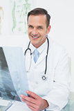 Portrait of a smiling male doctor with x-ray