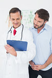 Male doctor discussing reports with patient