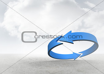 Blue arrow in a desert landscape