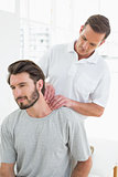 Male therapist massaging a young man's neck
