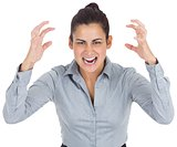Furious businesswoman gesturing