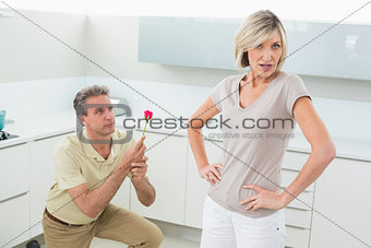 Man making a proposal to woman in kitchen