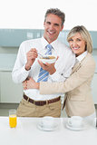 Loving couple having breakfast in kitchen